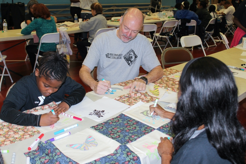 BC President J. David Armstrong, Jr. colors a picture for MLK Day