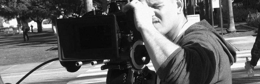Prefessor James Eimmerman looking through a video camera